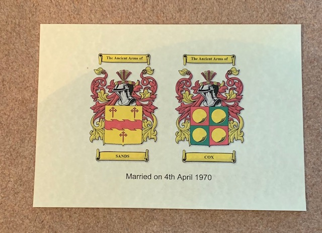 anniversary bond with two family crests and wedding date