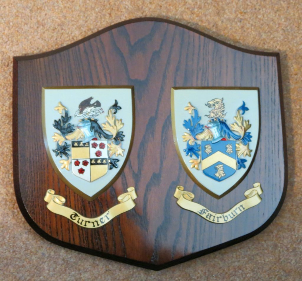 Shield with two family crests