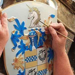 family shield with crest